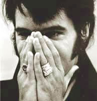 Elvis Presley Showing off His Rings