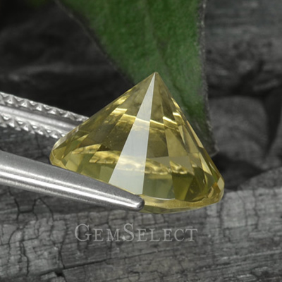 A Diamond-Cut Lemon Quartz Gem Held by the Girdle
