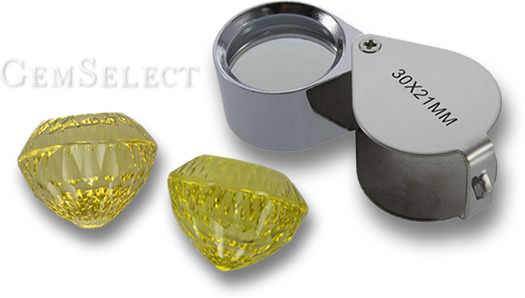 Inspecting Gemstones With a Jeweler's Loupe