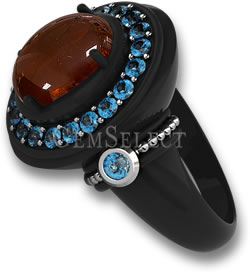 Black Metal Ring with Spessartite Cabochon Center Stone and Blue Topaz Halo