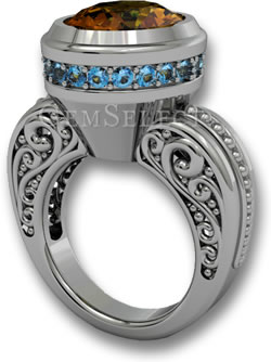 A Modern Take on the Halo: Silver Ring with Tourmaline Center Stone and Blue Topaz Outside Halo