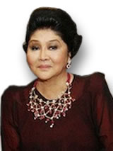Imelda Marcos Looking Imeldific in Ruby Jewelry