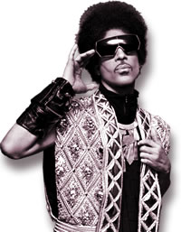 Prince in a Jewel-Encrusted Balmain Silver Vest and Breastplate Necklace