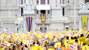 Thai People Dressed in Yellow to Show Respect for the King