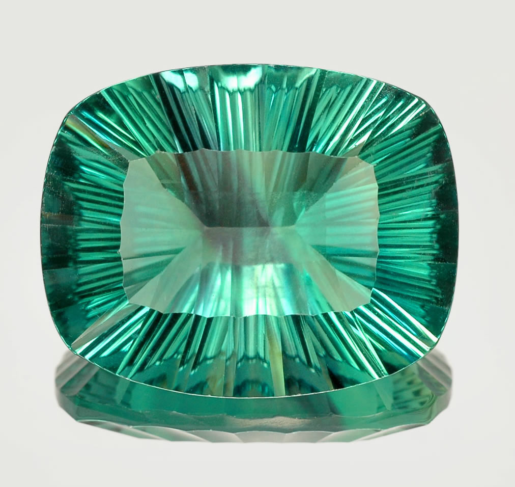 to world gemstone introduction of green gemstoneguru faceted emerald an the teal demystified emeralds
