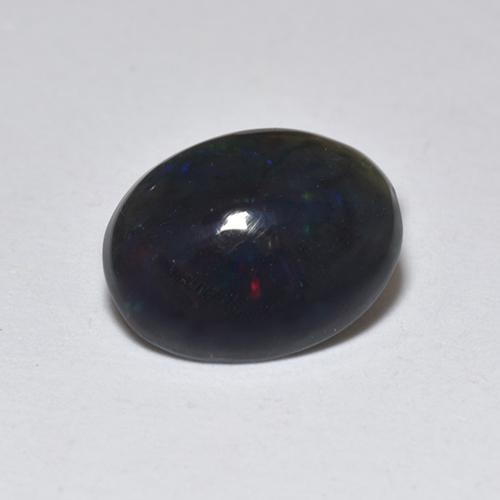 0.7ct Oval Cabochon Multicolor Black Opal Gem (ID: 518360)