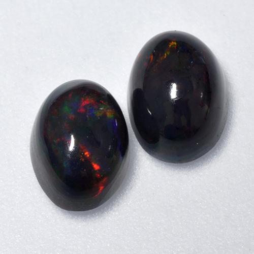 0.6ct Oval Cabochon Multicolor Black Opal Gem (ID: 518589)