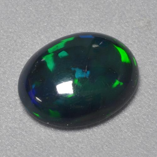 0.8ct Oval Cabochon Multicolor Black Opal Gem (ID: 519873)