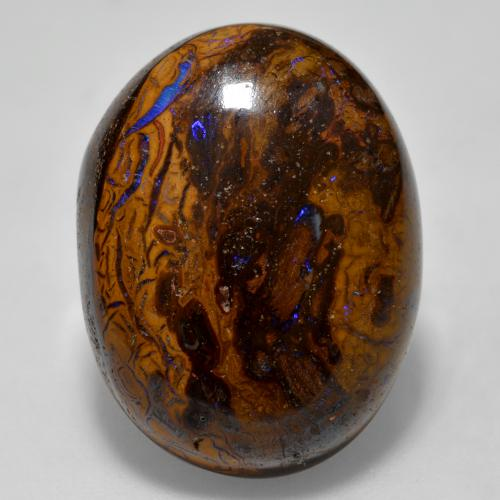 thumb image of 22.7ct Oval Cabochon Multicolor Boulder Opal (ID: 321842)