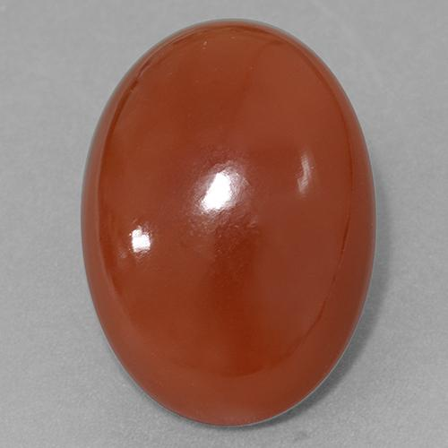 27.77 ct Oval Cabochon Red Orange Carnelian Gemstone 24.91 mm x 18.1 mm (Product ID: 510771)