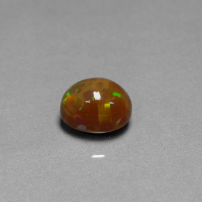 Buy 2.17 ct Multicolor Chocolate Opal 9.18 mm x 7.2 mm from GemSelect (Product ID: 302130)
