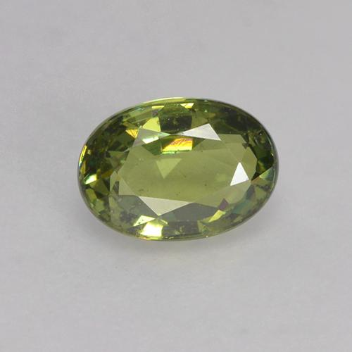 thumb image of 0.6ct Oval Facet Golden Green Demantoid Garnet (ID: 250566)