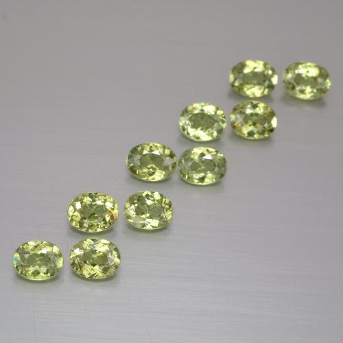 Golden Green Demantoid Garnet Gem - 0.2ct Oval Facet (ID: 387505)