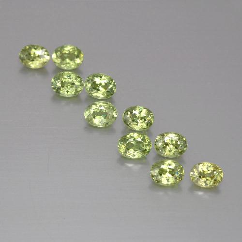 Golden Green Demantoid Garnet Gem - 0.2ct Oval Facet (ID: 387697)
