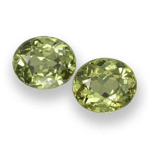 Golden Green Demantoid Garnet Gem - 0.5ct Oval Facet (ID: 458149)