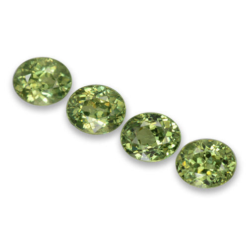 Golden Green Demantoid Garnet Gem - 0.5ct Oval Facet (ID: 458346)