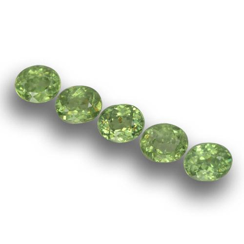 Golden Green Demantoid Garnet Gem - 0.4ct Oval Facet (ID: 458597)