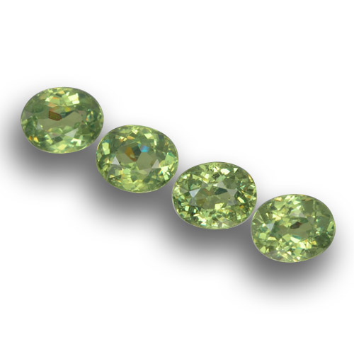 Golden Green Demantoid Garnet Gem - 0.4ct Oval Facet (ID: 458600)