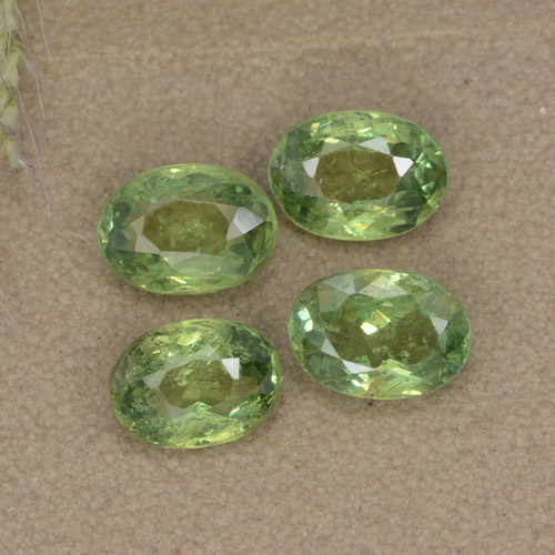 Golden Green Demantoid Garnet Gem - 0.6ct Oval Facet (ID: 478605)