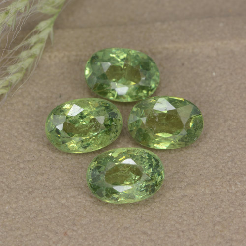 Golden Green Demantoid Garnet Gem - 0.7ct Oval Facet (ID: 478608)