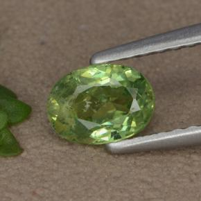 Warm Green Granate Demantoide Gema - 0.6ct Forma ovalada (ID: 478911)