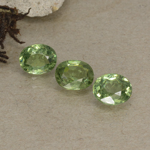 Golden Green Demantoid Garnet Gem - 0.5ct Oval Facet (ID: 499040)