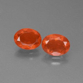 0.6ct Oval Facet Deep Reddish Orange Fire Opal Gem (ID: 450475)