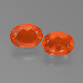 Deep Reddish Orange Fire Opal Gem - 0.6ct Oval Facet (ID: 450553)