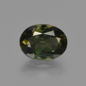 1.53 ct Oval Facet Deep Earth Green Kornerupine Gemstone 8.44 mm x 6.4 mm (Product ID: 423411)