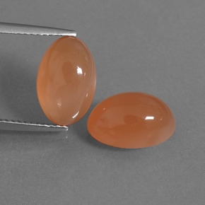 Light Reddish Orange Pietra di luna Gem - 3.6ct Ovale cabochon (ID: 403408)