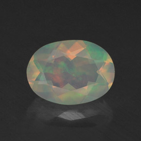 Buy 0.76 ct Multicolor Opal 8.03 mm x 5.9 mm from GemSelect (Product ID: 309336)