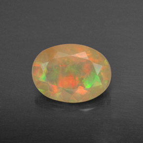 Buy 0.87 ct Multicolor Opal 8.04 mm x 6 mm from GemSelect (Product ID: 309395)