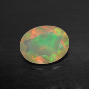 Buy 0.73 ct Multicolor Opal 8.05 mm x 6.1 mm from GemSelect (Product ID: 309440)