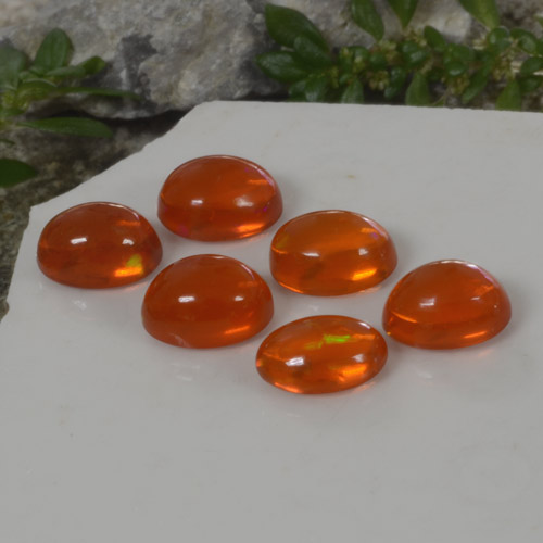 0.6ct Ovale Cabochon Medium Orange Opale gemme (ID: 368953)