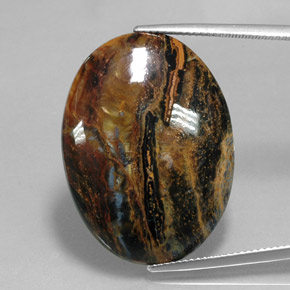 23.9ct Oval Cabochon Multicolor Pietersite Gem (ID: 347564)