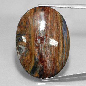 24.6ct Oval Cabochon Multicolor Pietersite Gem (ID: 348357)