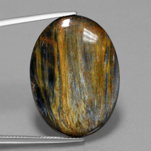 21.9ct Oval Cabochon Multicolor Pietersite Gem (ID: 447881)