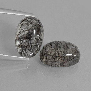 Colorless Black Rutile Quartz Gem - 5.4ct Oval Cabochon (ID: 403375)