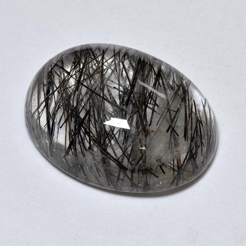 Colorless with Black Rutile Quartz Gem - 8.6ct Oval Cabochon (ID: 514204)