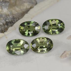 Yellowish Green Sapphire Gem - 0.6ct Oval Facet (ID: 262530)