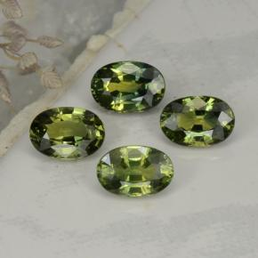 Yellowish Green Sapphire Gem - 0.7ct Oval Facet (ID: 262531)
