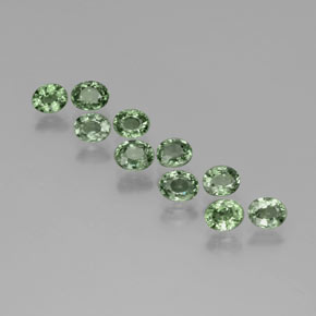 Green Sapphire Gem - 0.6ct Oval Facet (ID: 383431)
