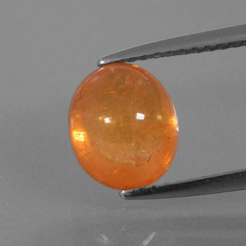 3.89 ct Oval Cabochon Orange Spessartite Garnet Gemstone 8.82 mm x 7.4 mm (Product ID: 390268)