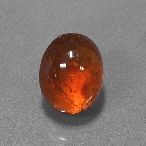 Red Orange Spessartite Garnet Gem - 7.1ct Oval Cabochon (ID: 424328)
