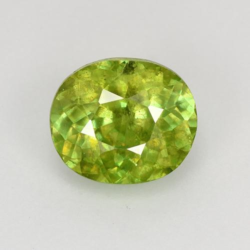 Lively Yellowish Green Sphene Gem - 1.1ct Oval Facet (ID: 526427)