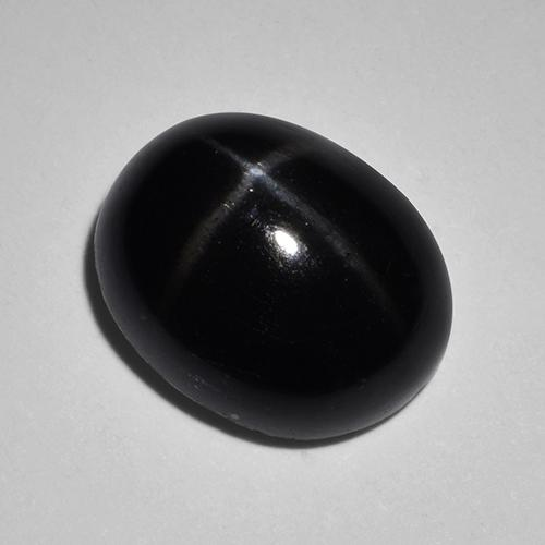 Black Star Diopside Gem - 4.8ct Oval Cabochon (ID: 514403)