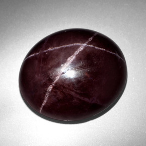 thumb image of 43ct Oval Cabochon Black Red Star Garnet (ID: 403894)