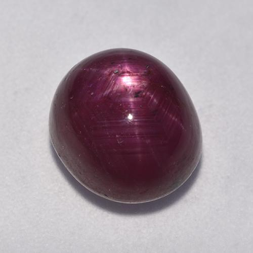 Pinkish Red Star Ruby Gem - 7.2ct Oval Cabochon (ID: 526400)