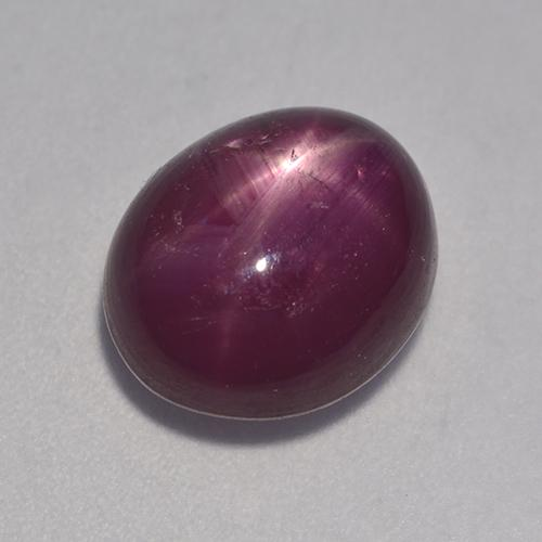 Pinkish Red Star Ruby Gem - 6.6ct Oval Cabochon (ID: 526408)