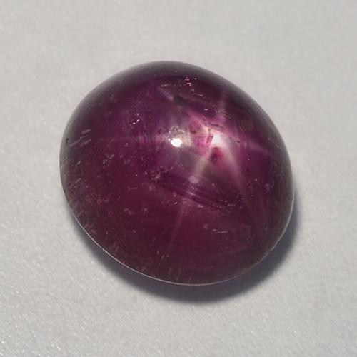 Pinkish Red Star Ruby Gem - 6.9ct Oval Cabochon (ID: 527410)